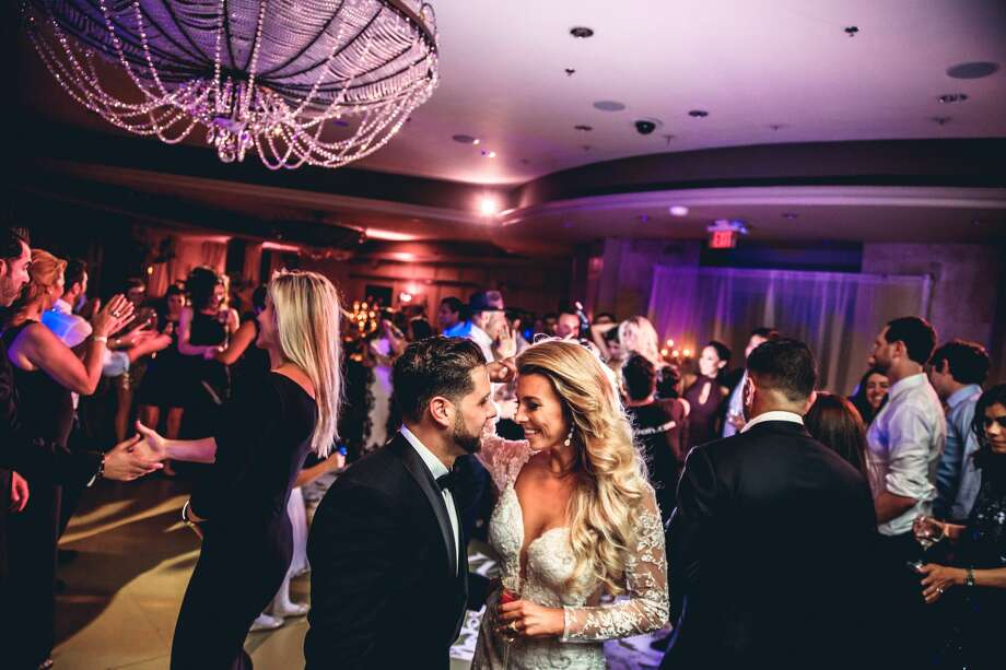 With the help of an incredible wedding staff, Amber and Romy Solanjl were able to pull off a romantic wedding despite the power going out throughout their wedding ceremony and reception. Photo: AISHA KHAN