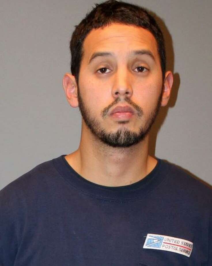 Dennis Hwang, 31, of Trumbull, Conn. was charged on Nov. 11, 2016 with sexually assaulting a local woman in her home. Hwang, a letter carrier who works out of the Westport post office, was charged with third-degree sexual assault and criminal trespass. Photo: Contributed Photo / Contributed Photo / Connecticut Post Contributed