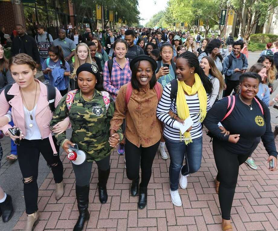 Hundreds of people from the Baylor University community escorted student Natasha Nkhama to class on Nov. 11, 2016 after she was the target of a racially charged incident on campus, she said.  Photo: Courtesy, Waco Tribune