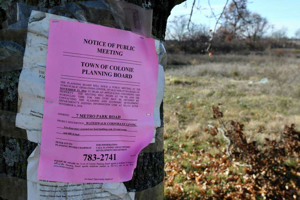 Notice of a Town of Colonie planning board meeting is posted at the site of a proposed hotel at 7 Metro Park Road on Monday, Nov. 14, 2016, in Colonie, N.Y. (Will Waldron/Times Union)