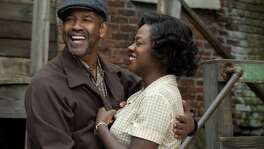 "Denzel Washington plays Troy Maxson and Viola Davis plays Rose Maxson in ""Fences,"" reprising their roles from the Tony Award-winning play. Both could be nominated for Academy Awards."