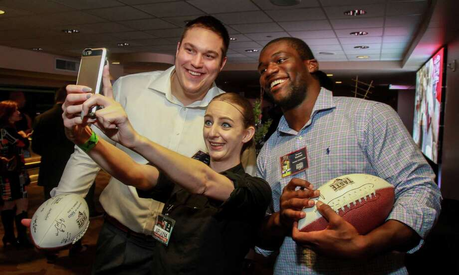 Ariana Atkinson, center, takes a selfie with Texans Nick Martin, left, and Shakeel Rashad at Taste of the Texans.  (For the Chronicle/Gary Fountain, November 14, 2016) Photo: Gary Fountain, Gary Fountain/For The Chronicle / Copyright 2016 Gary Fountain