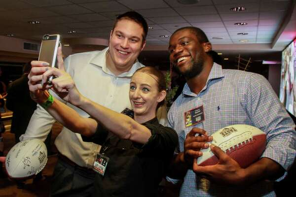 Ariana Atkinson, center, takes a selfie with Texans Nick Martin, left, and Shakeel Rashad at Taste of the Texans.  (For the Chronicle/Gary Fountain, November 14, 2016)
