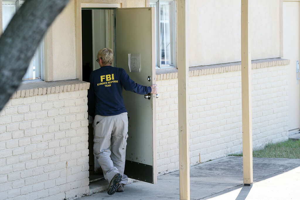 An FBI Agent Enters The Sidet Door Of The Family Medicine Office Of Javier  C.