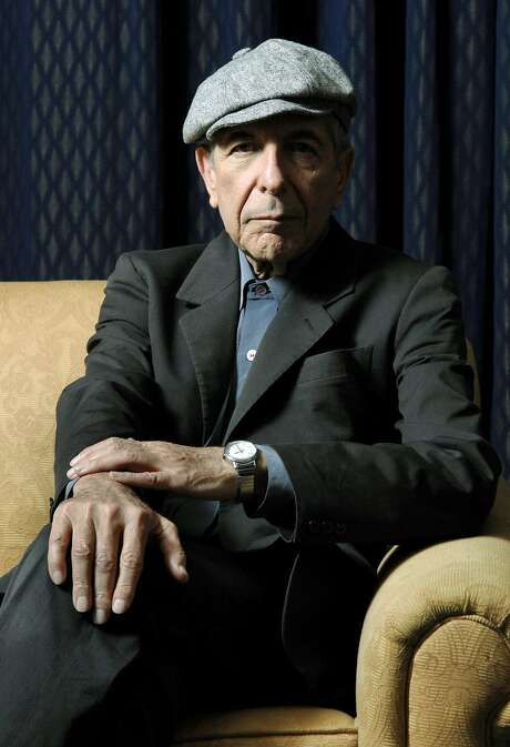 """Cat-lover Leonard Cohen in 2008. His description of his problems in 2007: """"Taxes/ children/ lost pussy/ war/ constipation."""" Photo: Aaron Harris, AP"""