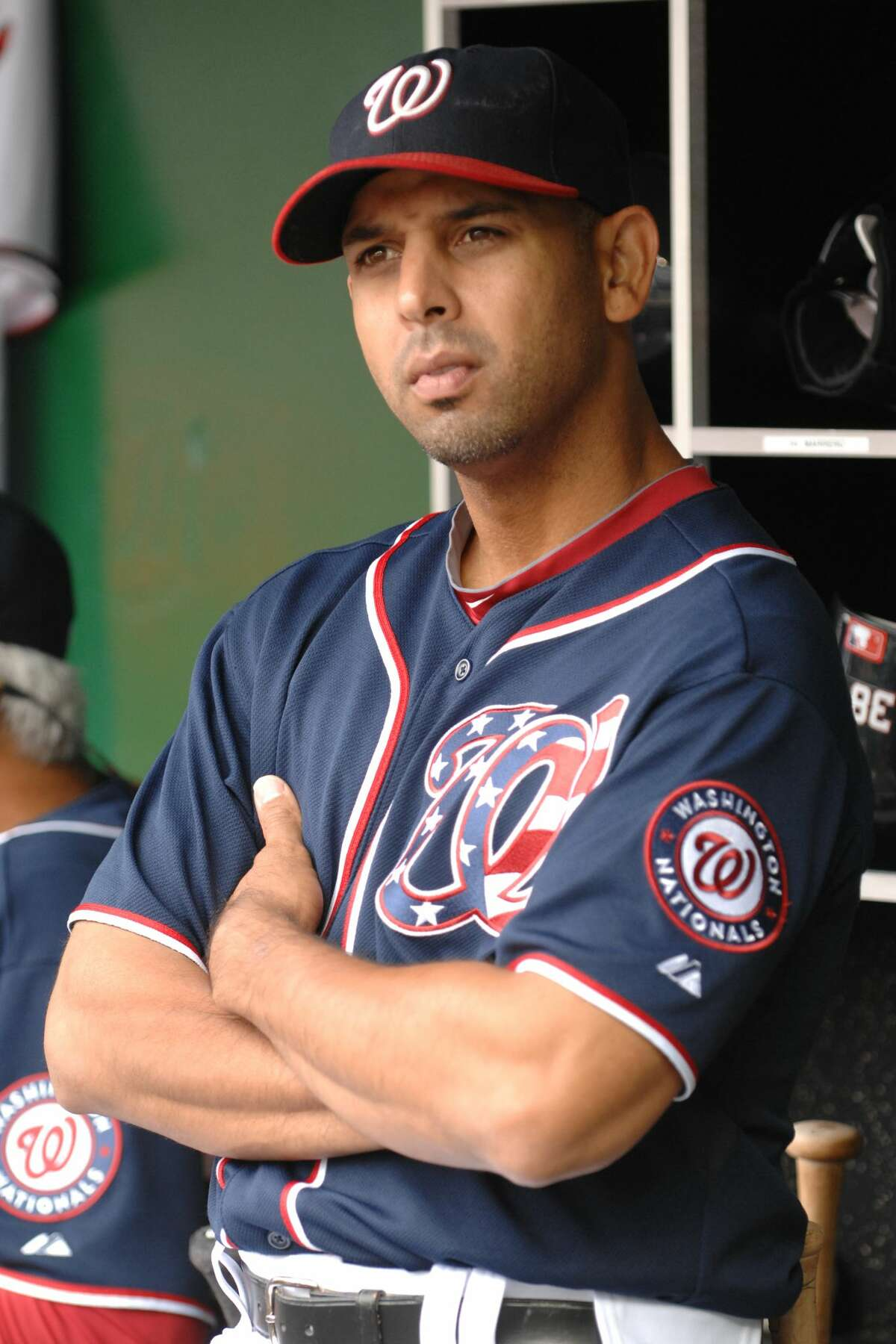WASHINGTON, DC - SEPTEMBER 5: Alex Cora #13 of the Washington Nationals looks on from the dugout before a baseball game against the Los Angeles Dodgers at National Park on September 5, 2011 in Washington DC. The Nationals won 7-2. (Photo by Mitchell Layton/Getty Images)