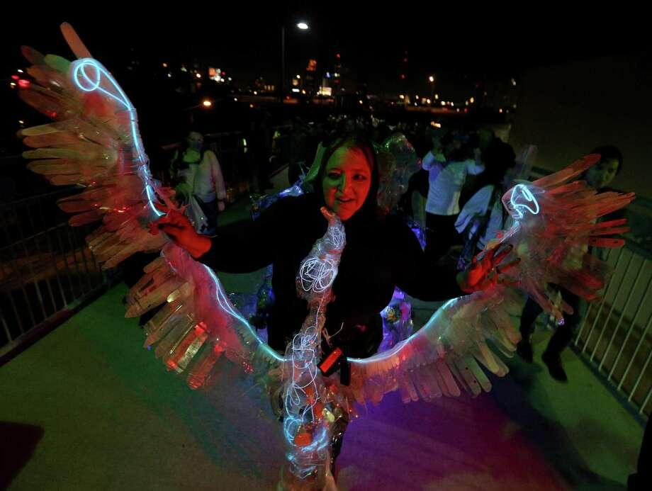 "Artist Margaret Craig debuted her work ""Albatross"" during Luminaria Thursday on the Hays Street Bridge. Photo: Edward A. Ornelas /San Antonio Express-News / © 2016 San Antonio Express-News"
