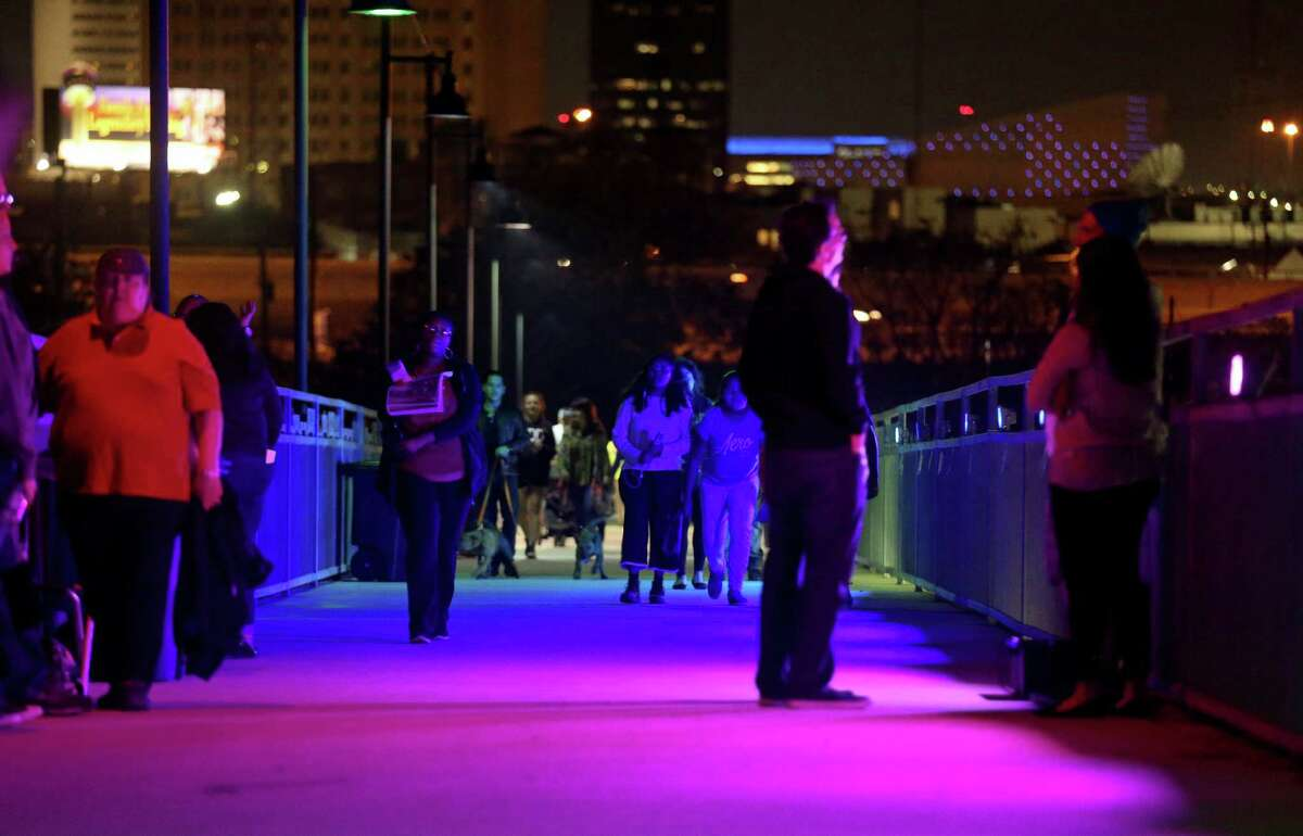 "People walk through Brett Elmendorf's ""Lumina-R-G-B"" during the Luminaria arts festival."