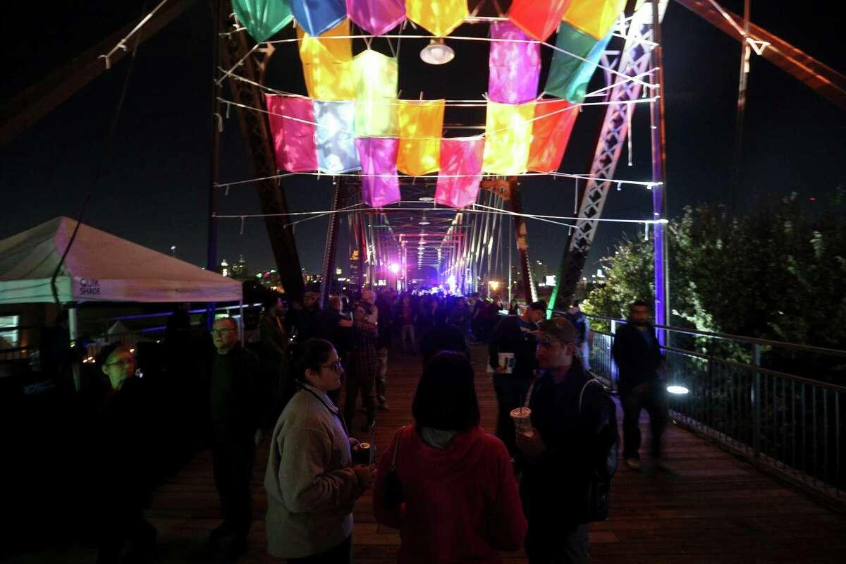People gather on the Hays Street Bridge during the Luminaria arts festival Nov. 10, 2016.