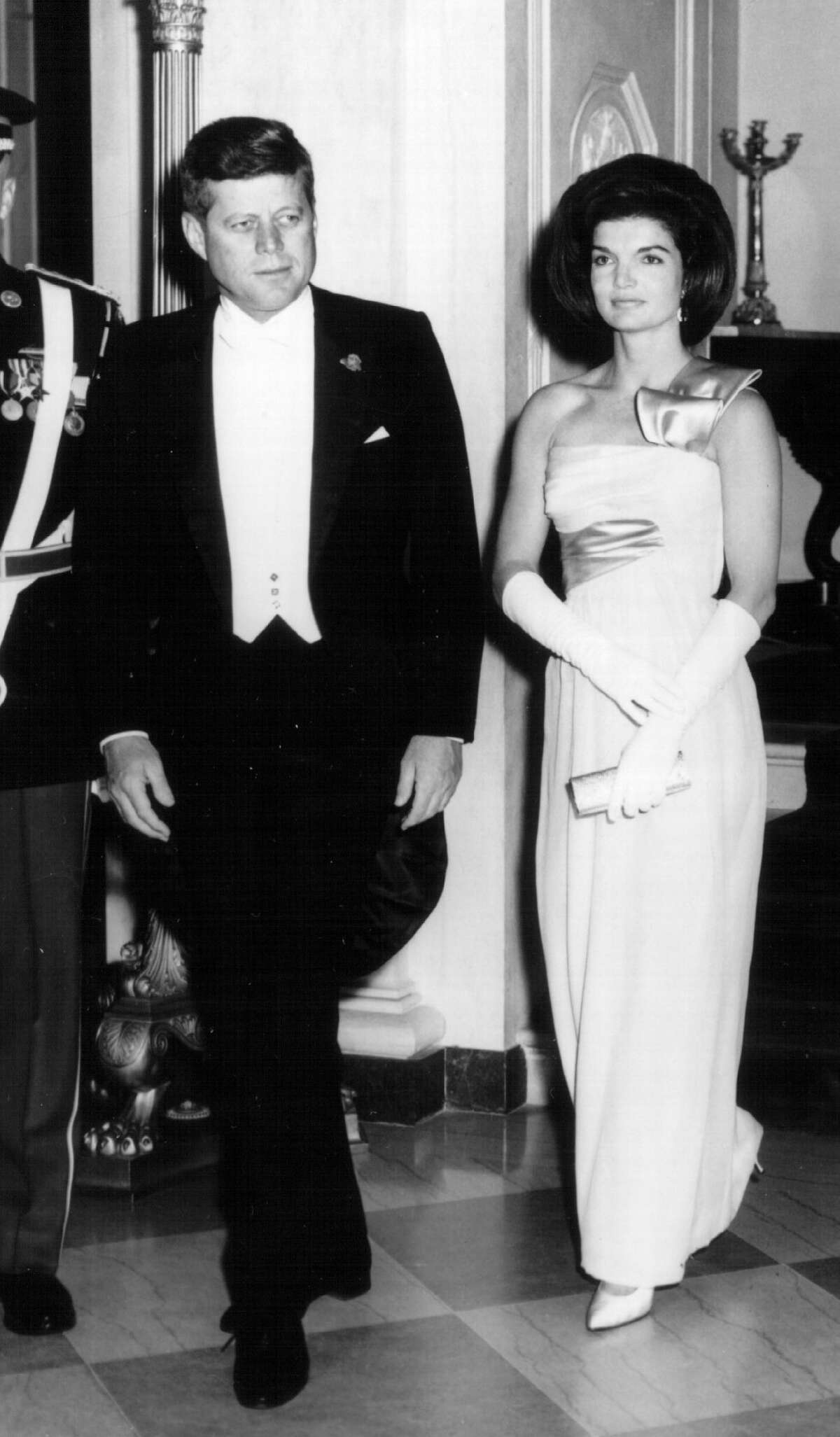 President John F. Kennedy and First Lady Jackie Kennedy attend a White House Ceremony in January 1963.