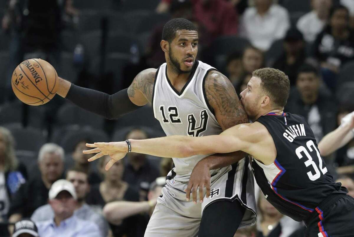 Spurs forward LaMarcus Aldridge is pressured by Los Angeles Clippers forward Blake Griffin during the first half on Nov. 5, 2016, in San Antonio.