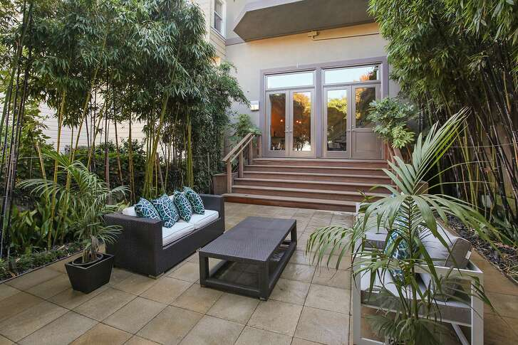 The lower level steps out to a landscaped backyard with tile patio.�