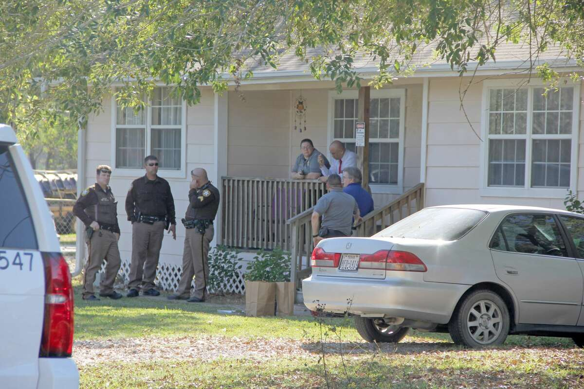 Brazoria County Sheriff Department deputies are investigating a deadly shooting in connection with a home invasion robbery around 8:30 a.m. Tuesday, Nov. 15, 2016, in Rosharon. A woman reported two masked gun men kicked down her back door and demanded money. A family member who lives across the street heard the commotion and came to help. Detectives say a shootout ensued which left one of the alleged robbers dead. The other suspect escaped.
