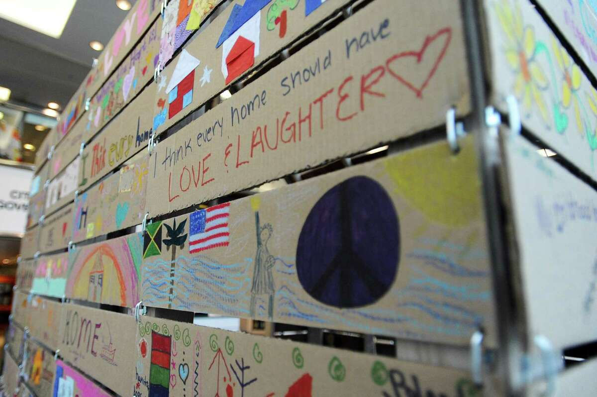 The art installation HOME, located in the lobby of Government Center, comprises panels written by homeless locals about their definition of what home is. Photographed in Stamford.