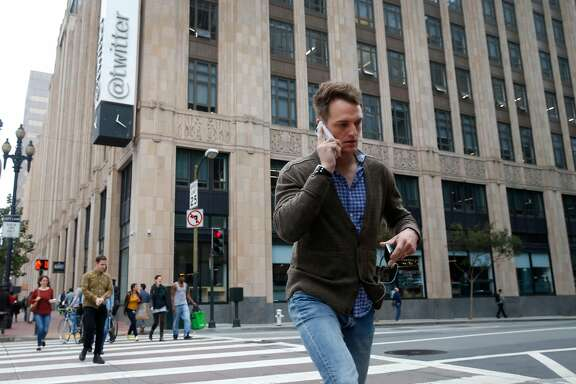 A man crosses 10th Street in front of the Twitter building on Market Street in San Francisco, Calif. on Tuesday, Nov. 15, 2016.