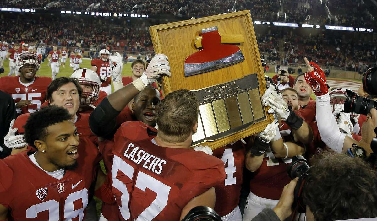 Stanford players celebrate the win with the Stanford Axe as they beat California 35-22 in the 118th Big Game at Stanford Stadium, on Sat. November 21, 2015, in Stanford, Calif.
