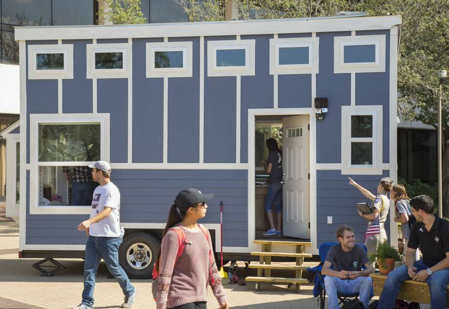 Students at the Texas A&M College of Architecture recently completed two tiny homes for the homeless. Photo: Texas A&M College Of Architecture