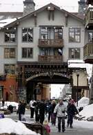 Skiers walk in from the parking lott into the village. The Village at Squaw valley. FALLSKI06B_0071_kr.JPG 2/17/05 in NORTH LAKE TAHOE,CA. KURT ROGERS/THE CHRONICLE