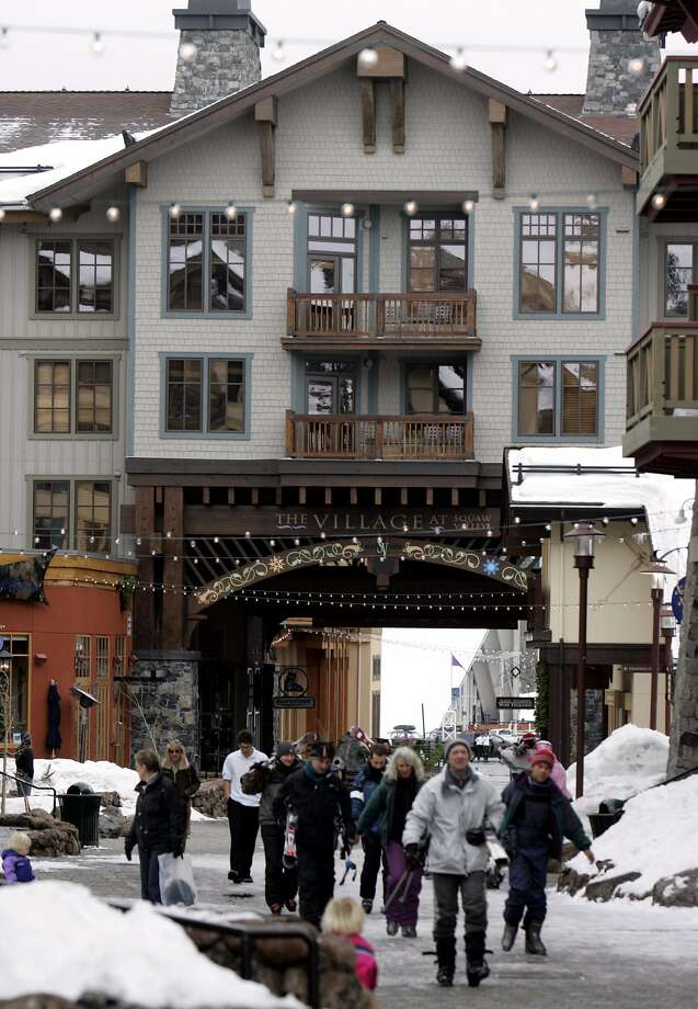 Skiers walk from the parking lot into the village at Squaw Valley. Photo: KURT ROGERS, SFC
