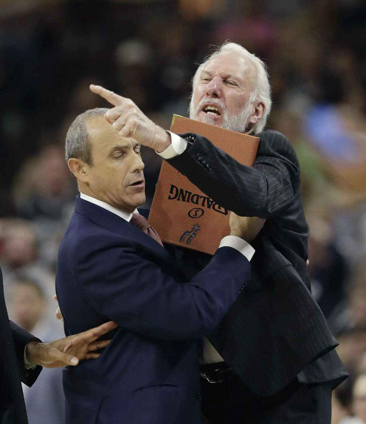 Spurs coach Gregg Popovich is held back by assistant coach Ettore Messina as he argues an official's call during the first half against the Los Angeles Clippers on Nov. 5, 2016, in San Antonio.