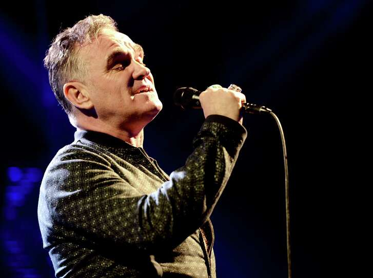 FILE – MARCH 11:  It was reported March 11, 2013 that singer Morrissey has been hospitalized with pneumonia in San Francisco, California and has rescheduled some of his concert dates. LOS ANGELES, CA - MARCH 01:  Singer Morrissey performs at The Staples Center on March 1, 2013 in Los Angeles, California.  (Photo by Kevin Winter/Getty Images)