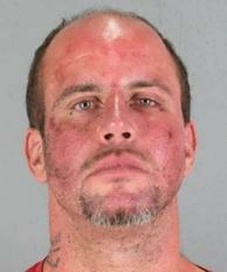 Michael Goggins, 34, pleaded no contest to felony threats to a police officer and misdemeanor hate crime charges, officials said. Photo: San Mateo County Sheriff's Office / /