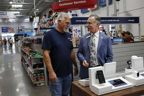 "The Mayor of Livermore, John Marchland, right, chats with a customer, Richard Westword during a press event promoting the new SmartSpot by B8ta retail spaces in a few select California Lowe's department stores Nov. 15, 2016 inside the Lowe's in Livermore, Calif. The retail areas showcase ""smart home"" devices that allow customers to interact with each one and provides a sales representative for questions and concerns."