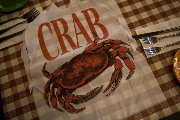 A crab bib is displayed at the Cippino's restaurant on Sunday, Mar. 2, 2014 in San Francisco, Calif. Cioppino's is a  a popular restaurant at the wharf and manages to keep a fairly old-school menu of San Francisco specialties