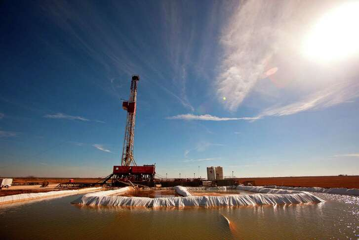 FILE - This Feb. 17, 2016 file photo shows a water pool attached to Robinson Drilling rig #4 in Midland County, Texas. Oil drilling companies and royalty owners from the Texas Panhandle to New Mexico's stretch of the Permian Basin are embarking on a grass-roots campaign aimed at salvaging what they say is a major sector of the U.S. economy, and their target is foreign oil imports.  (James Durbin/Midland Reporter-Telegram via AP, File)