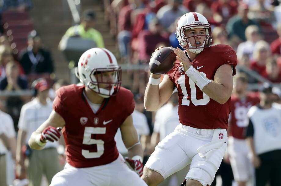 Stanford quarterback Keller Chryst seems to have improved quite a bit in the past week or two. Of course, it's comforting for any QB to have Christian McCaffrey (No. 5) in the backfield. Photo: Marcio Jose Sanchez, Associated Press