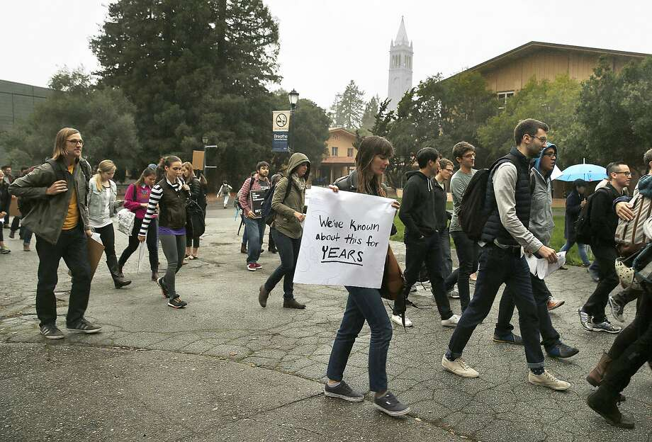 UC Berkeley graduate student in public health and city planning Sarah Skenazy (with large white sign) protests university rules surrounding sexual harassment investigations outside of Wurster Hall at UC Berkeley on Tuesday, November 15, 2016, in Berkeley, Calif. Photo: Liz Hafalia, The Chronicle