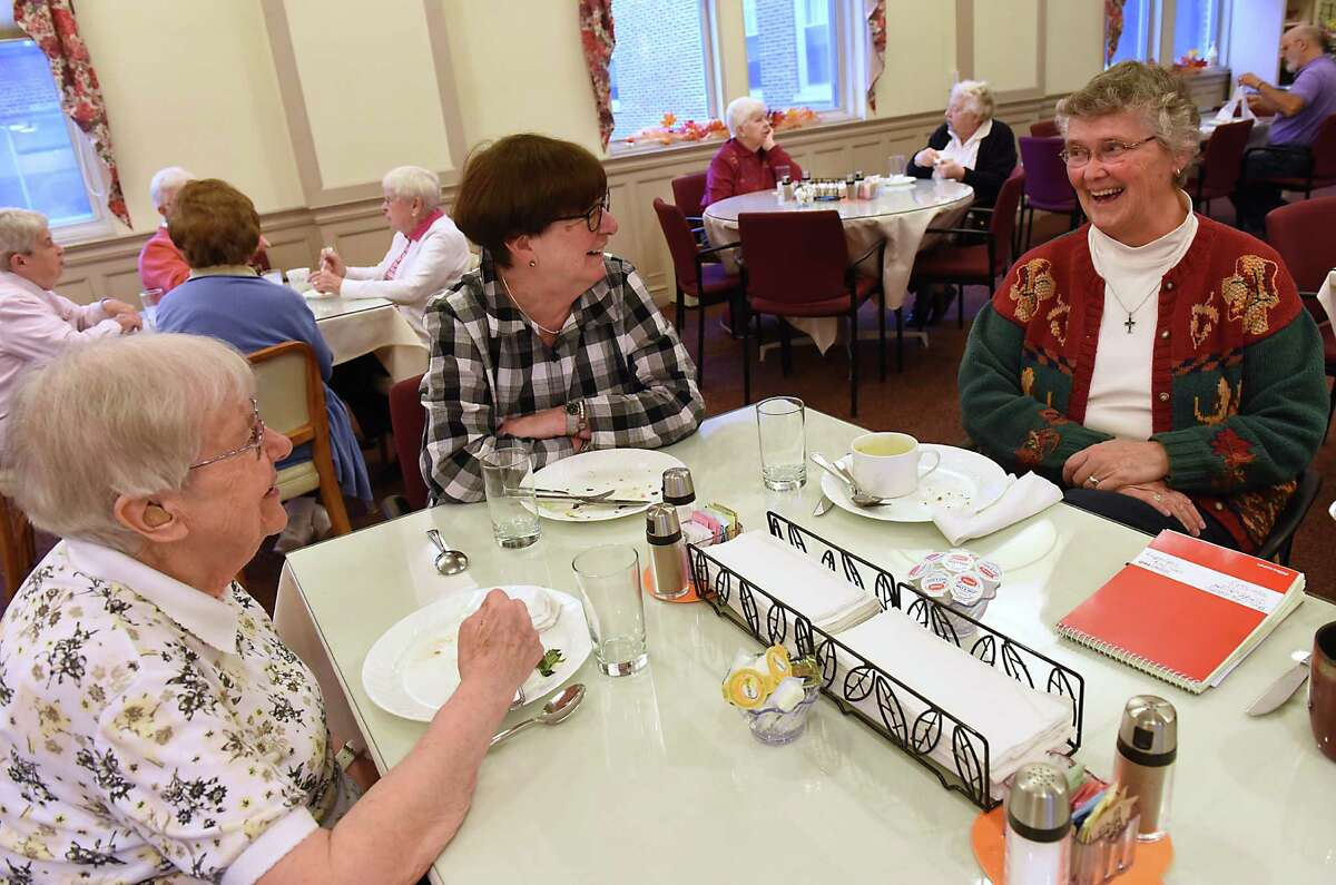 From left, Sr. Mary Cabrini Nellis, 70 years in convent, Sr. Mary Fraser, 50 years in convent, and Sr. Kathleen Pritty, 54 years in convent and co-local coordinator of Sisters of Mercy chat after enjoying a lunch at Sisters of Mercy on Tuesday, Nov. 15, 2016 in Albany, N.Y. (Lori Van Buren / Times Union)