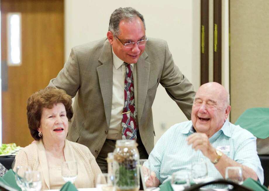 John Burge, right, laughs along side his wife Susan and Willis City Manager Hector Forestier during the Greater Conroe/Lake Conroe Area Chamber of Commerce annual Emerald Club luncheon at the North Montgomery County Community Center Tuesday, Nov. 15, 2016, in Willis. John Burge served as chairman of the chamber in 1982. Photo: Jason Fochtman, Staff Photographer / Houston Chronicle