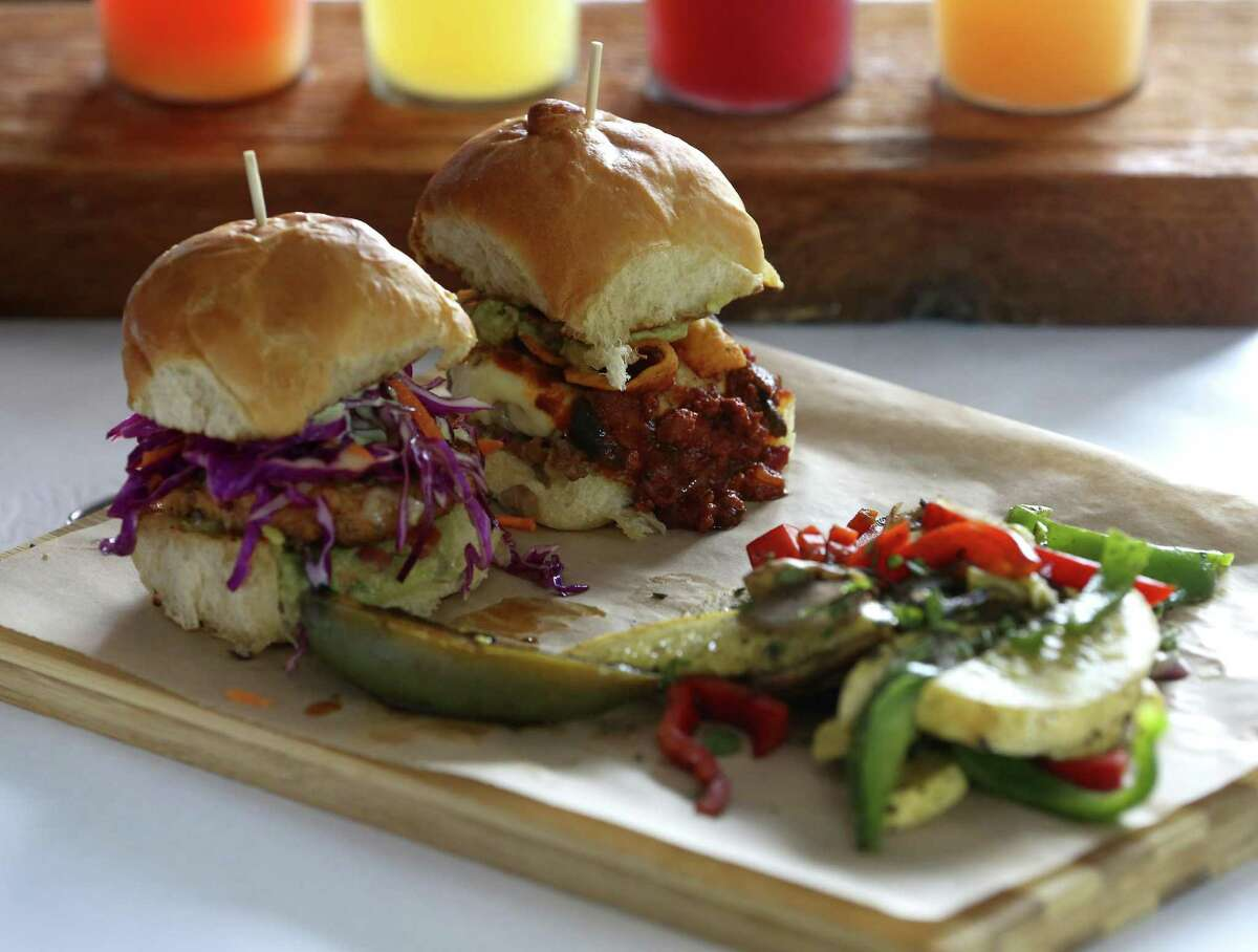 The slider plate with Deep Blue, left, and Dirty Sanchez, right, sliders served with grilled vegetables from Sangria on the Burg