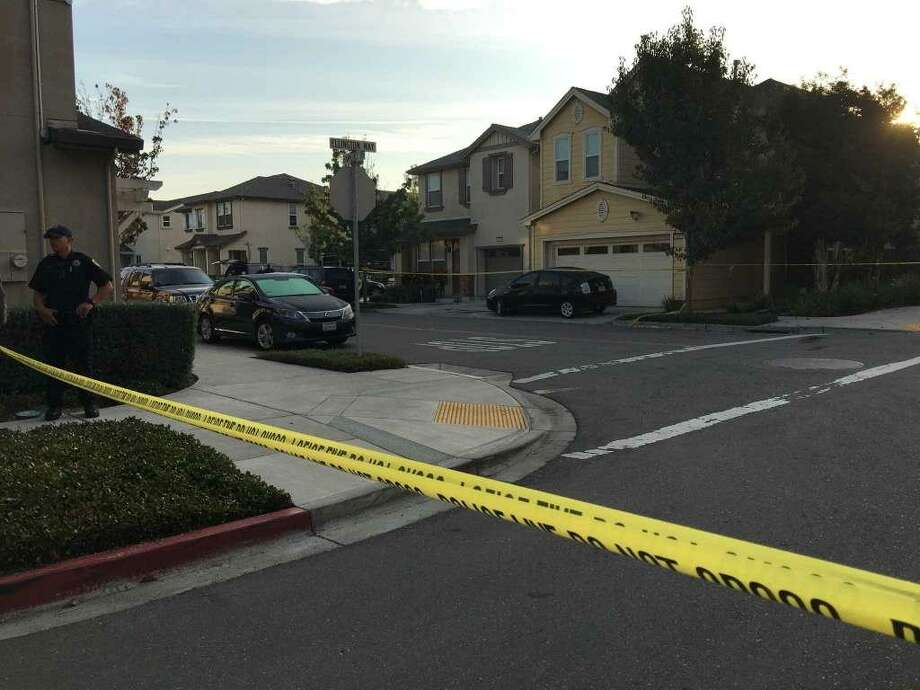 Crime-scene tape surrounds the area near a home where FBI agents probe a triple slaying in Oakland. Photo: Kimberly Veklerov / The Chronicle / Kimberly Veklerov / The Chronicle