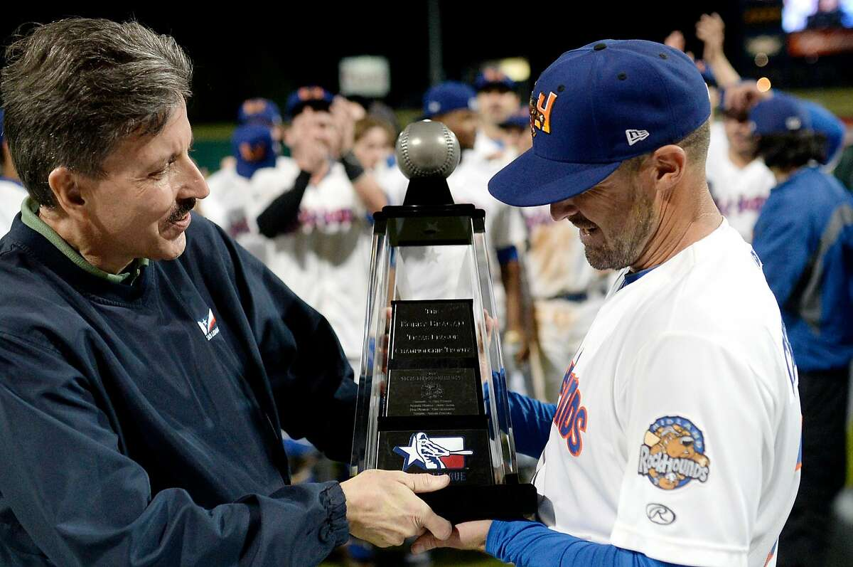 Texas League president Tom Kayser presents RockHounds manager Ryan Christenson with the Texas League trophy after beating Northwest Arkansas in the Texas League Championship series on Friday, Sept. 16, 2016 at Security Bank Ballpark. James Durbin/Reporter-Telegram