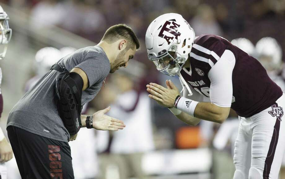 Texas A&M quarterback Trevor Knight bows with teammate Jake Hubenak (10) before the start of the game against Ole Miss on Nov. 12, 2016, in College Station. Photo: Sam Craft /Associated Press / AP