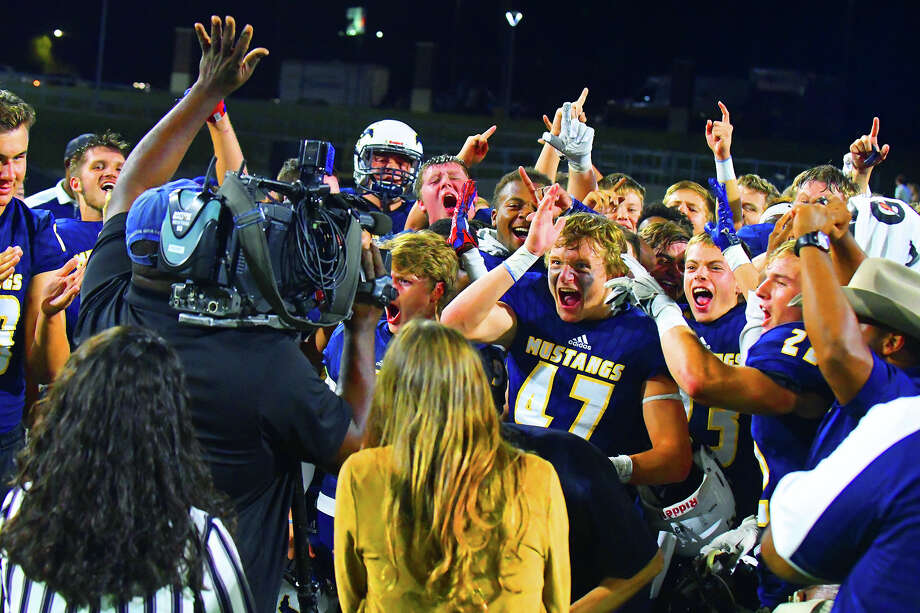 The Cy Ranch Mustangs celebrate their 27-24 win against Cy Ridge Friday at Ken Pridgeon Stadium. Senior kicker Dominick White sealed the victory with a 22-yard field goal and the Mustangs clinched at least a share of the district title and remained unbeaten this season. Photo: Tony Gaines / HCN, HCN