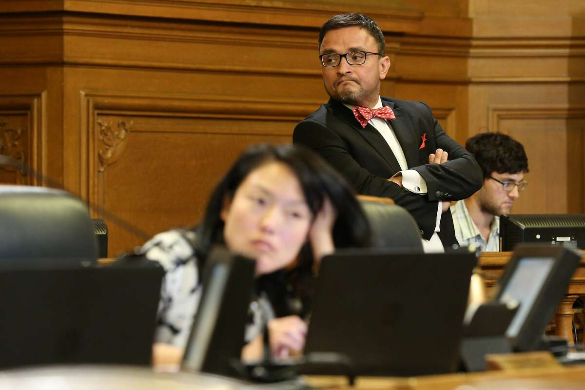 Supervisors David Campos and Jane Kim (seen blurred in the foreground) during a Board of Supervisors meeting at City Hall, on Tuesday, Nov. 15, 2016 in San Francisco, Calif.