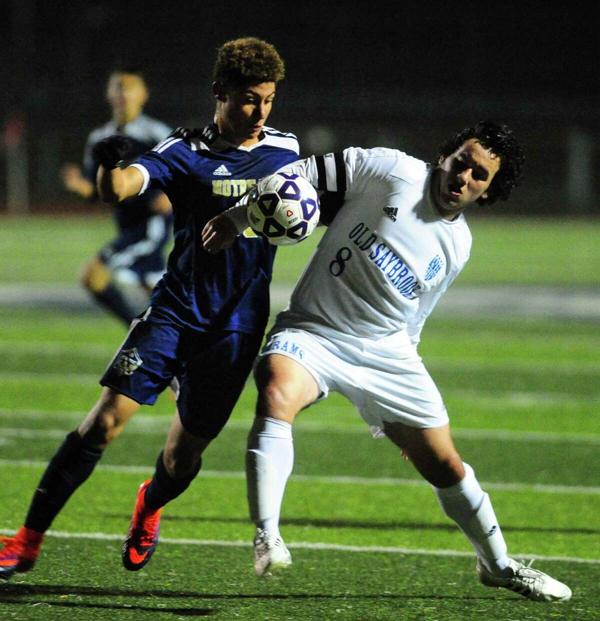 Old Saybrook's Ben VanVliet, right, tries to head off Notre Dame of Fairfield's Felipe Canzian during Class S boys soccer semi-final action in West Haven, Conn. on Tuesday Nov. 15, 2016.