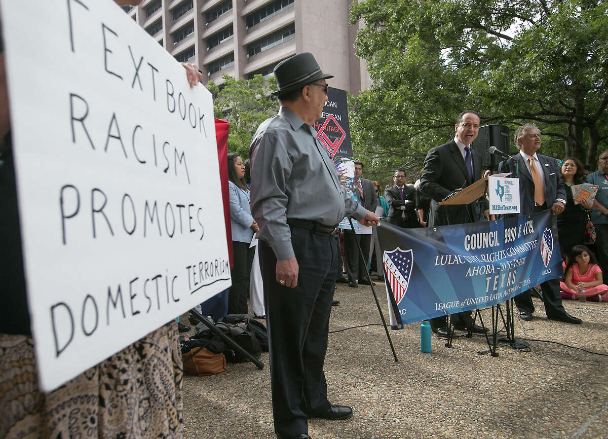"""Texas State Sen. Jose Menedez speaks at a rally for Mexican-Americans outside the State Board of Education. Mexican-American advocates and activists gathered for a rally outside the William B. Travis state office building Tuesday Sept. 13, 2016, to express their displeasure with the State Board of Education's controversial proposed textbook """"Mexican American Heritage"""", which lists several inaccuracies and false information about Texas' rich cultural heritage. After the rally the board held a public hearing on the topic and others at their regularly scheduled meeting. (Ralph Barrera/Austin American-Statesman via AP)"""