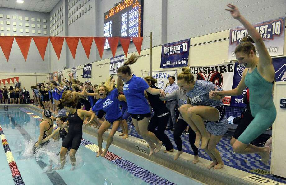 Darien celebrates winning its sixth straight CIAC Class L girls swimming championship at Southern Connecticut State University's Hutchinson Natatorium in New Haven on Tuesday. Photo: Matthew Brown / Hearst Connecticut Media / Stamford Advocate