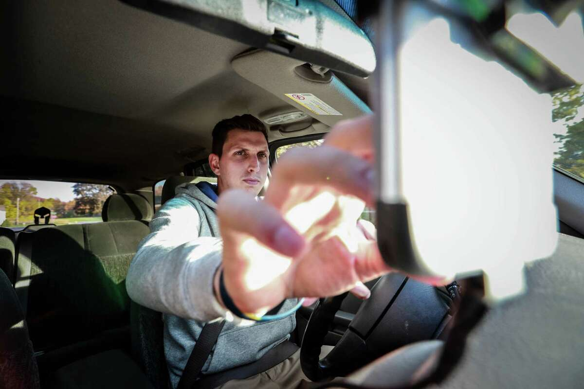 To reduce the time he looks at his smartphone, Brett Hudson of Jackson, Mich., installed an aftermarket Bluetooth system for hands-free phone calls. Hudson concedes that the setup is not risk-free. Highway deaths have surged in the past two years, and experts point to in-car use of such phones.