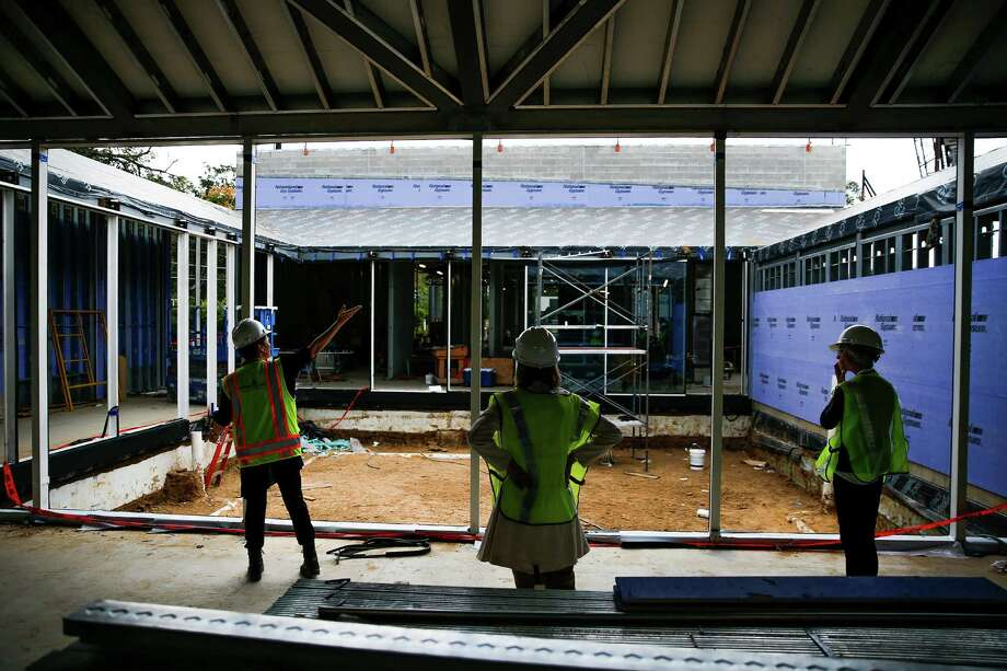 Menil Collection deputy director Sheryl Kolasinski, left, leads a tour of the construction of the Menil Drawing Institute, designed by Johnston Marklee, Thursday, Nov. 3, 2016 in Houston. Photo: Michael Ciaglo, Houston Chronicle / © 2016  Houston Chronicle