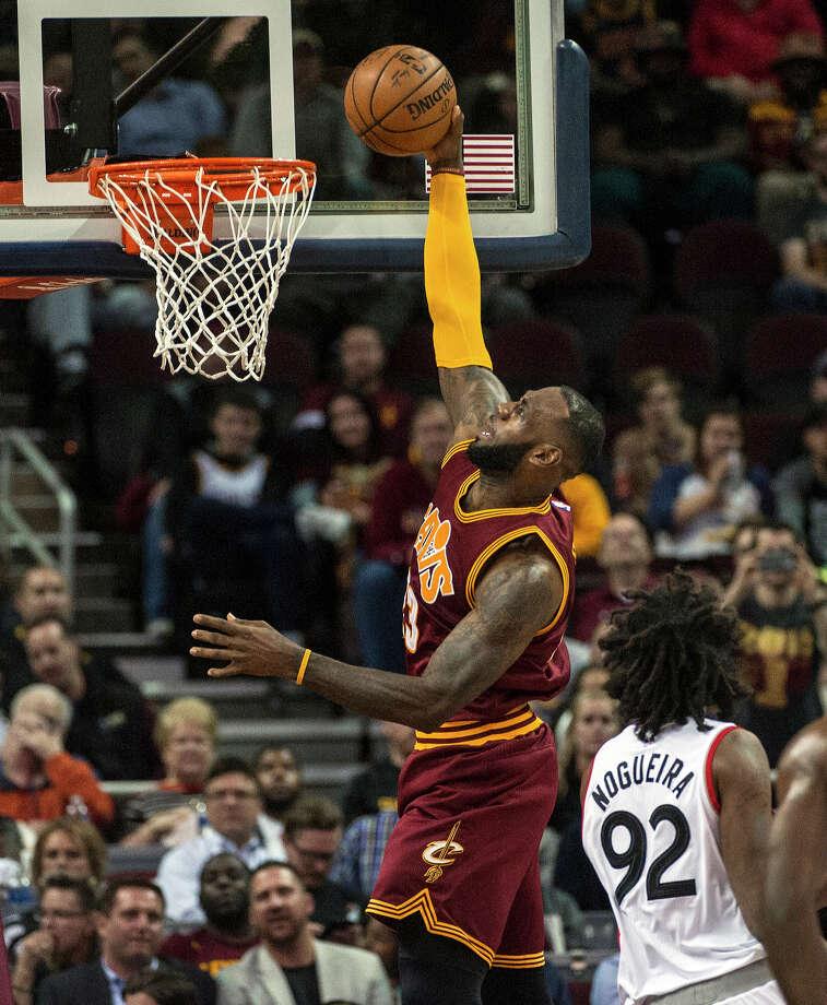 301a2a42dfd1 Cleveland Cavaliers  LeBron James makes a basket as Toronto Raptors  Lucas  Nogueira (92