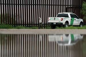 A U.S. Customs and Border Patrol agent passes birdwatcher Nancy Hill, 81, along a section of the border wall Sunday, Nov. 13, 2016, in Hidago, Texas. President-elect Donald Trump is starting to sound a lot more like President Barack Obama on his stance on immigration and easing his pledge to build a wall across the Mexican border.  (AP Photo/Eric Gay)