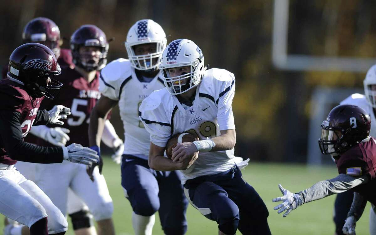 King quarterback Renn Lints carries the ball against St. Luke's during Saturday's game at Pedrick Stadium's Watson Field in New Canaan. Lints scored three touchdowns, leading King to a 36-0 victory.