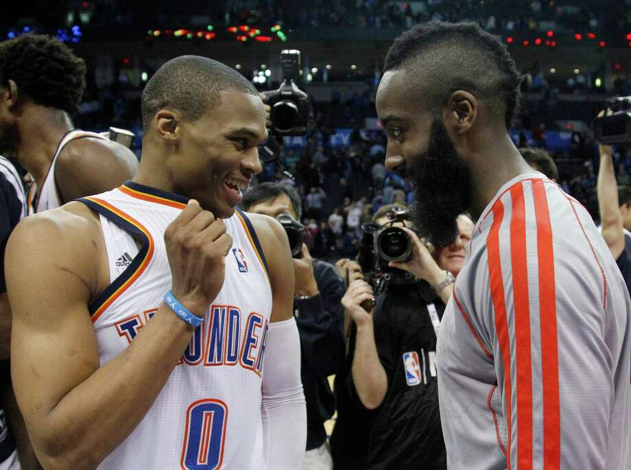 Russell Westbrook, left, and James Harden are friendly rivals after having played together for three seasons with the Thunder. Photo: Sue Ogrocki, STF / AP