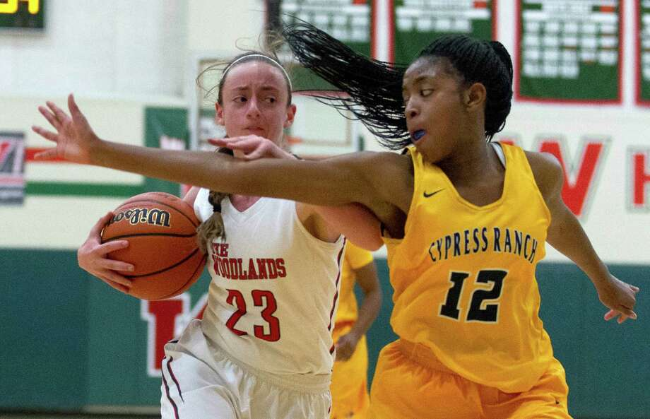 The Woodlands guard Amanda Maresca (23) tries to get past Cypress Ranch guard Shady Thomas (12) during the third quarter of a non-district high school girls basketball game at The Woodlands High School Tuesday, Nov. 15, 2016, in The Woodlands. Photo: Jason Fochtman, Staff Photographer / Houston Chronicle