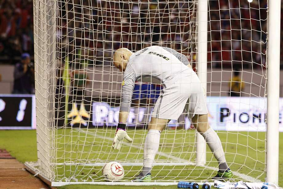 U.S. goalkeeper Brad Guzan retrieves the ball after host Costa Rica scored its fourth goal in Tuesday's 2018 World Cup qualifying match. Costa Rica won 4-0. Photo: Moises Castillo, Associated Press